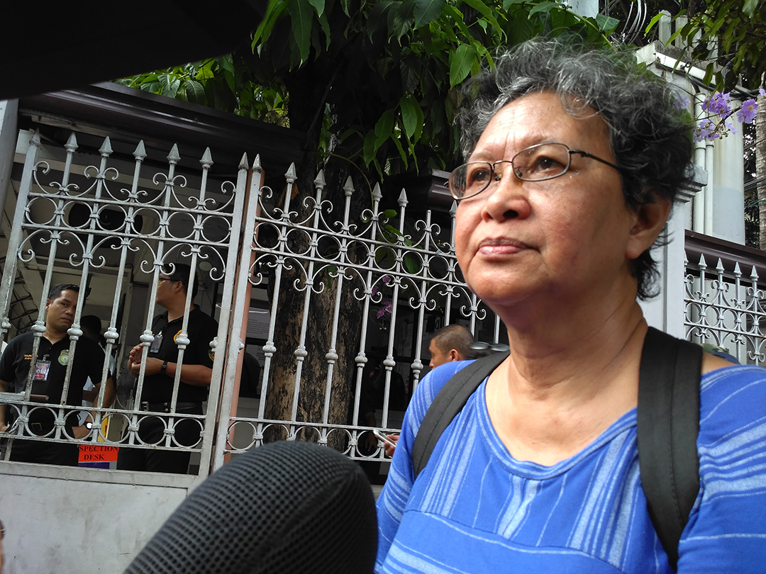 Eyes red from tears, SELDA chairperson Marie Hilao-Enriquez says she is angry and disappointed with the Supreme Court decision allowing Ferdinand Marcos to be buried at the Libingan ng mga Bayani. (Photo by Ronalyn V. Olea/ Bulatlat)