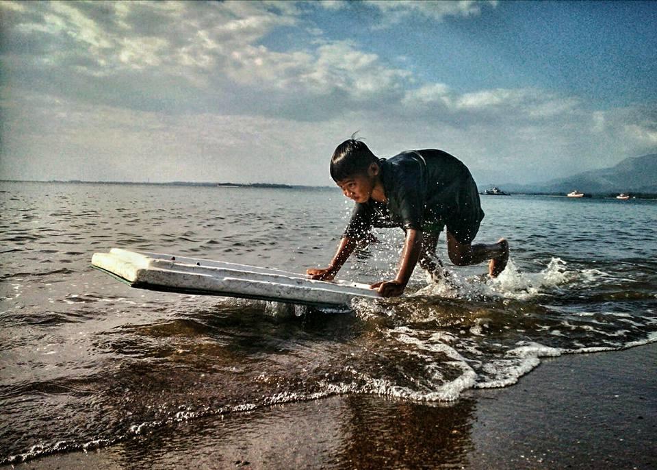 child surfing in Zambales
