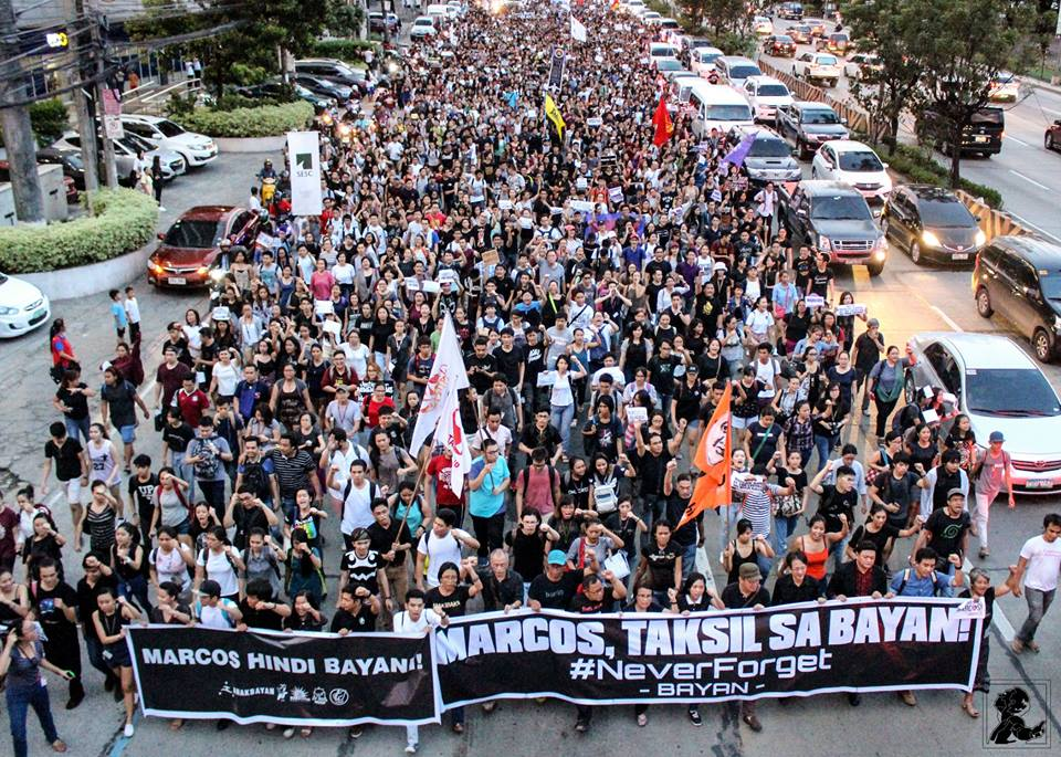 UP students, faculty and workers march with other activists along Katipunan, to meet up with their counterpart from Miriam College and Ateneo (Photo courtesy of Chester Higuit/Philippine Collegian)