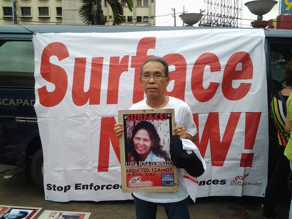 NDFP Peace consultant Ruben Saluta holds a poster of missing Panay leader Luisa Dominado (Contributed photo)