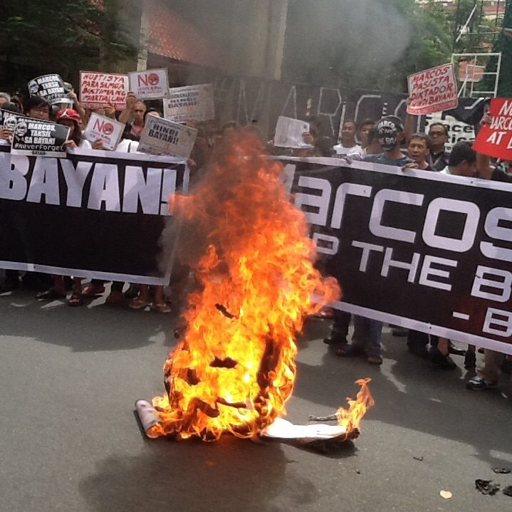 "Activists burn ousted Dictator Marcos ""head"" at the end of the protest in front of UP-PGH along Taft avenue, Manila. Photo by Dee Ayroso/Bulatlat)"