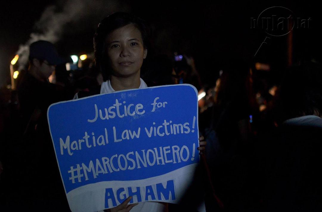A student joins the protest condemning Supreme Court decision allowing Marcos to be buried at the Libingan ng mga Bayani. (Photo by Loi Manalansan / Bulatlat)