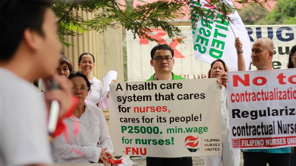 Members of the Filipino  Nurses United picketing in front of the Philippine General Hospital during the Philippine Nurses' Week last October. (Photo grabbed from FNU official Facebook page)