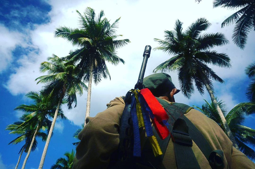 A New People's Army under the coconut trees. In their anniversary statement, the NPA is confident and relies on the correct guidance of the Communist Party of the Philippines CPP to achieve its gigantic general and specific tasks ahead. (Photo by CLEMENTE BAUTISTA)