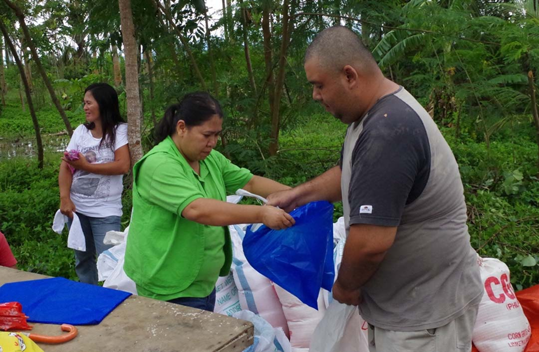 Rogina Quilop (in green vest and polo) repacks relief good for victims of Haiyan last year. (Photo courtesy of CPRS)
