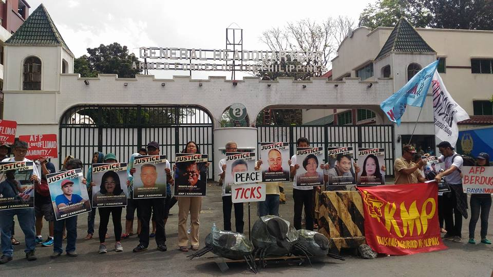 Peasant and human rights groups protest at the gates of  the AFP headquarters in Camp Aguinaldo on March 10 (Photo courtesy of Kathy Yamzon)