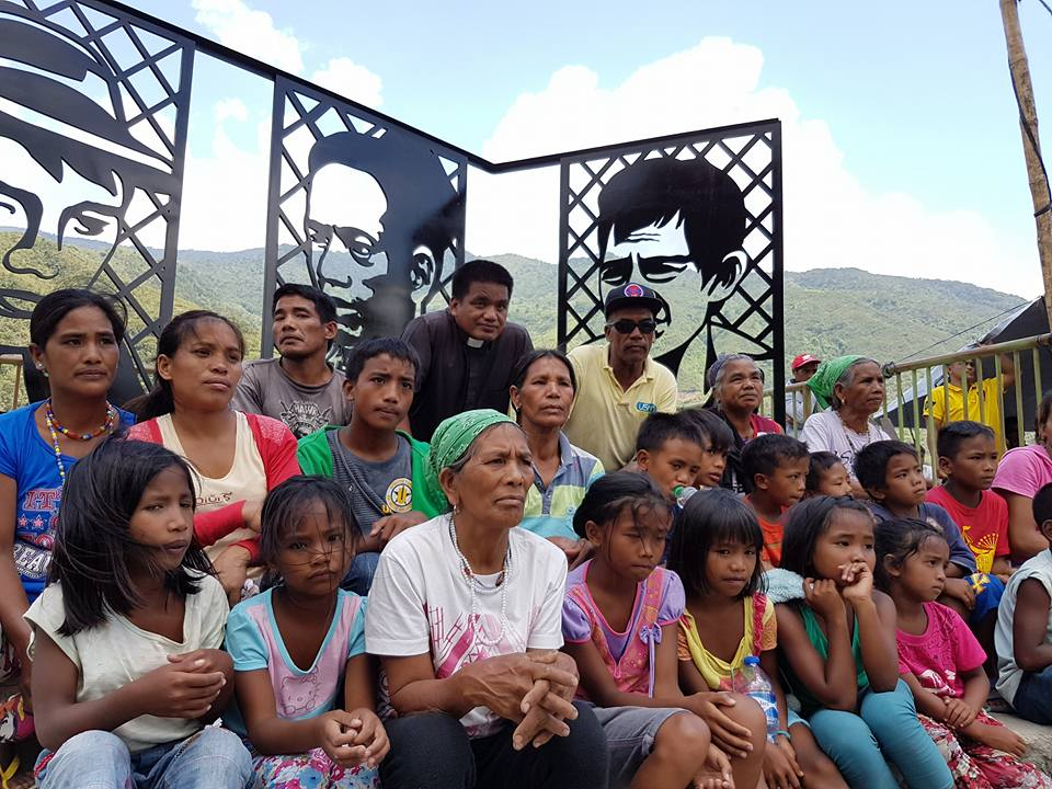 Descendants of Lumbaya Gayudan, Pedro Dungoc Sr and Macliing Dulag sit in front of the marker in Tinglayan, Kalinga (Photo courtesy of Audrey Beltran)