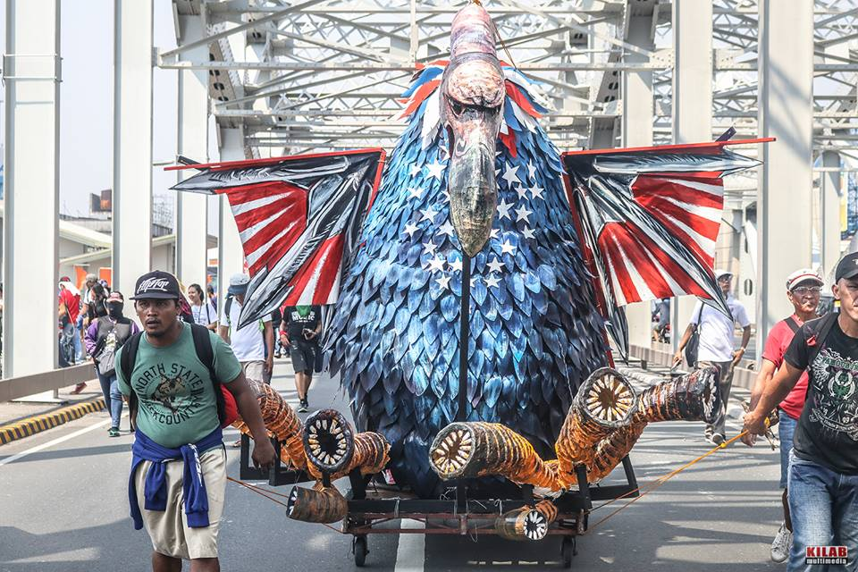 "RAPACIOUS. A star-spangled vulture with blood-suckers for claws represented the proletariat's biggest enemy: monopoly capitalism, led by the US. The effigy was not burned, merely ""battered"" by progressive leaders with replica bolos. (Photo by Kilab Multimedia)"