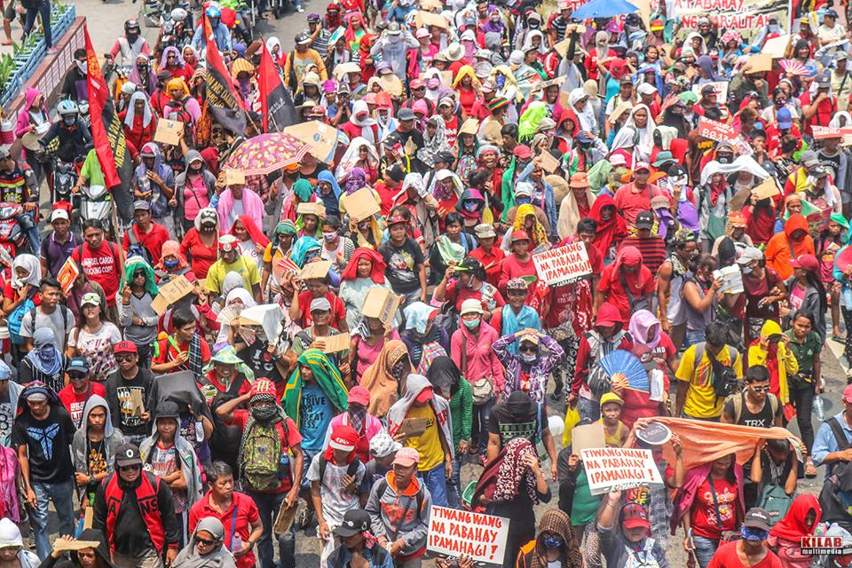 Urban poor from the occupied government housing units in Pandi, Bulacan made up the biggest bulk of the May Day protesters (Photo by Kilab Multimedia)