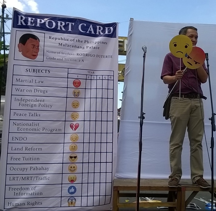 "SAD, ANGRY. Renato Reyes Jr of Bayan said the ""emojis"" in the ""report card"" for President Duterte indicates his failure to deliver on his promise of change (Photo by Dee Ayroso/Bulatlat)"