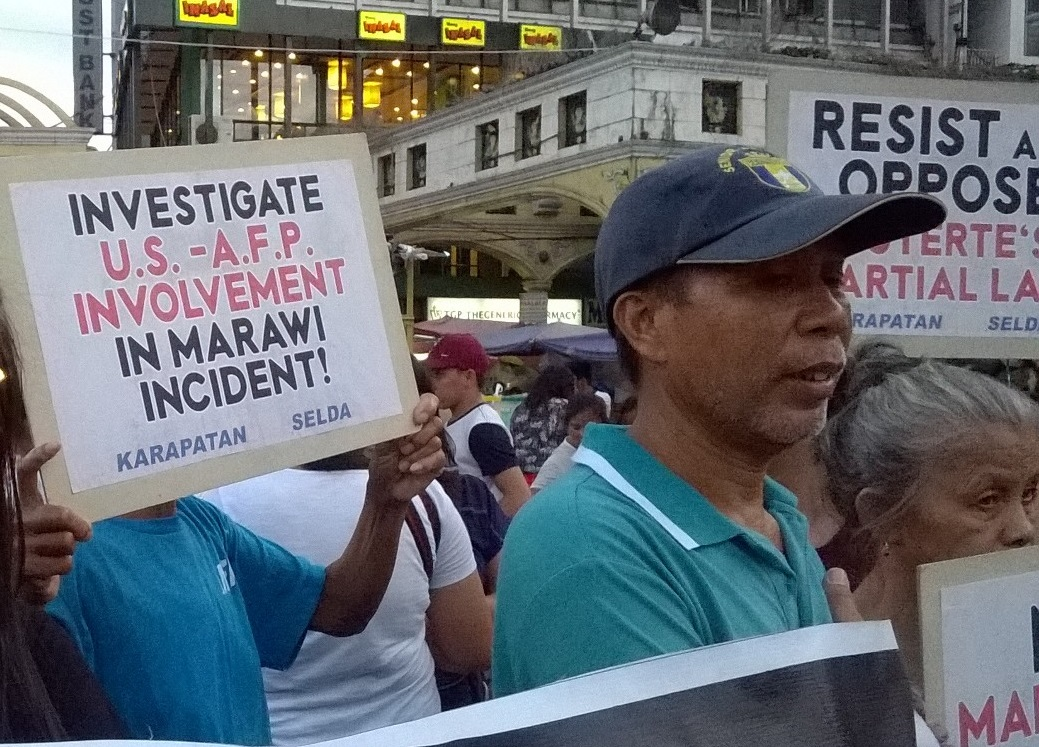 Jose Ceriales (in bull cap) at joins the protest against martial law in Mindanao at Plaza Miranda on May 24 (Photo by Dee Ayroso/Bulatlat)