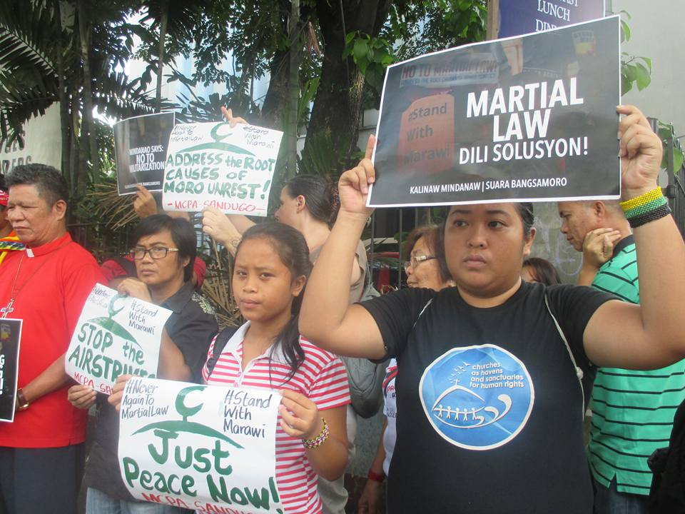 Progressives protest against martial law in Mindanao outside the NCCP gates in Quezon City on May 31, 2017 (Photo by Lito Ocampo)