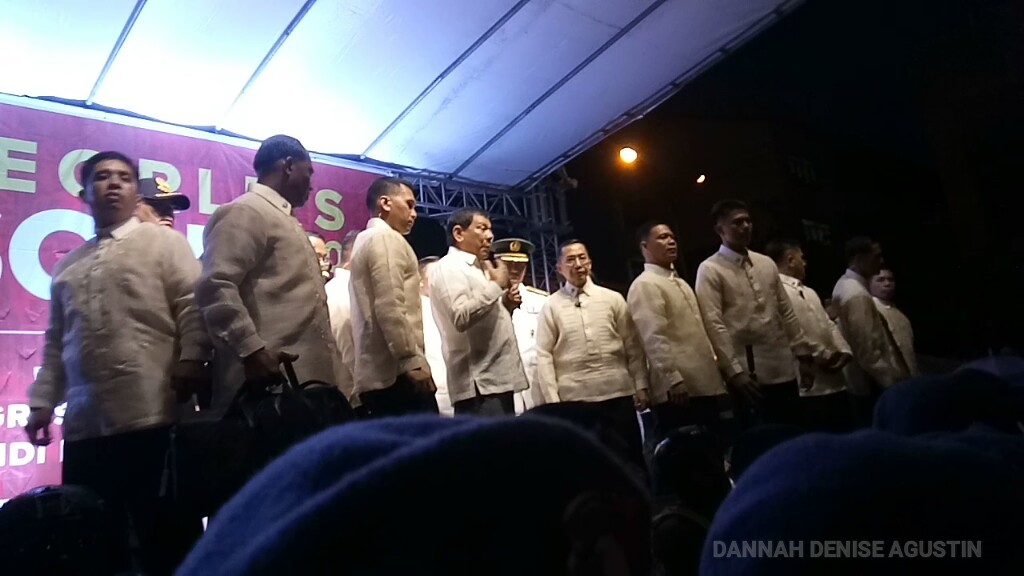 President Duterte on the stage of the People's SONA rally. On the stage with him are PSG men, while below stand a SWAT team, more PSG men, and on the outer ring, police women facing protesters. (Photo by Dannah Denise Agustin/Bulatlat)