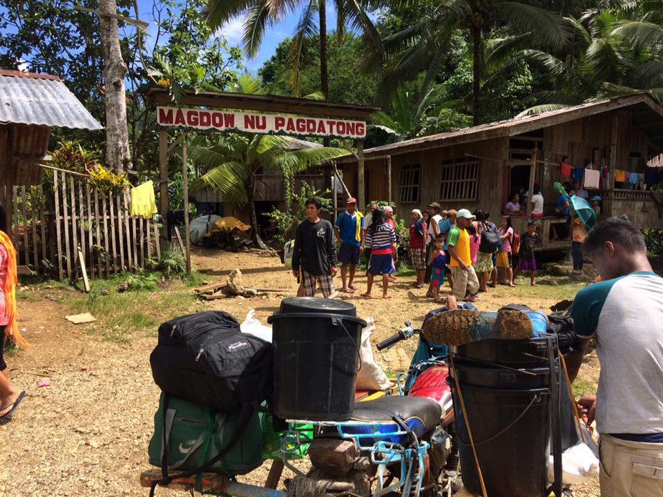 Residents and students of the Lumad schools in Han-ayan community in Diatagon village, Lianga, Surigao del Sur get ready to evacuate on July 5. (Contributed photo)
