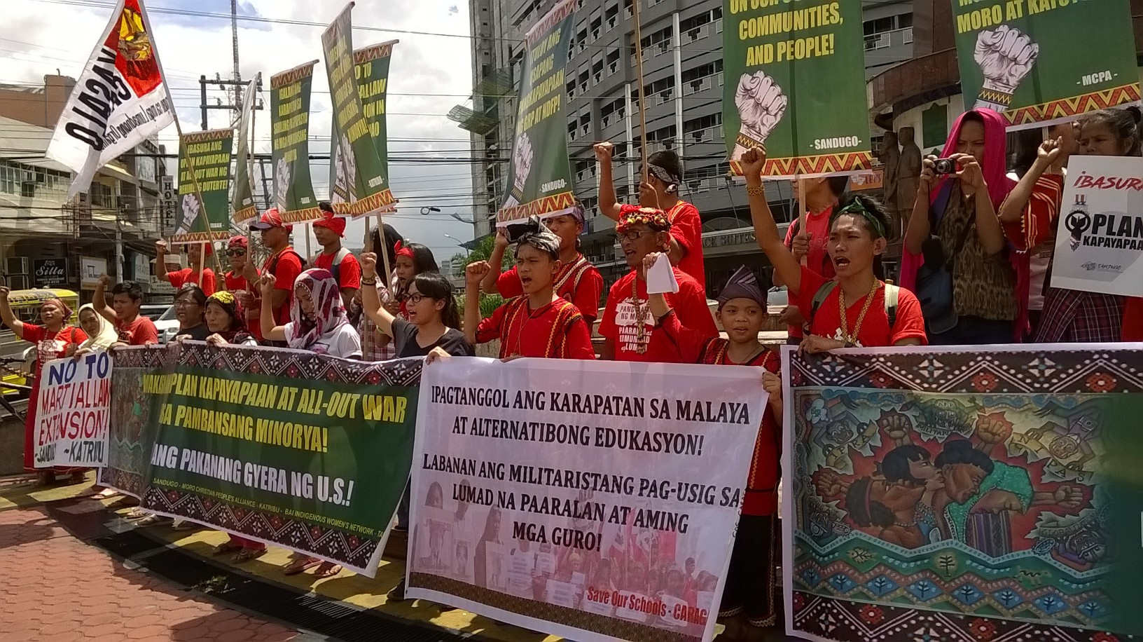 Lumad students and teachers the indigenous peoples from Luzon in a protest at the Boy Scout Circle in Timog, Quezon City (Photo by Dee Ayroso/Bulatlat)