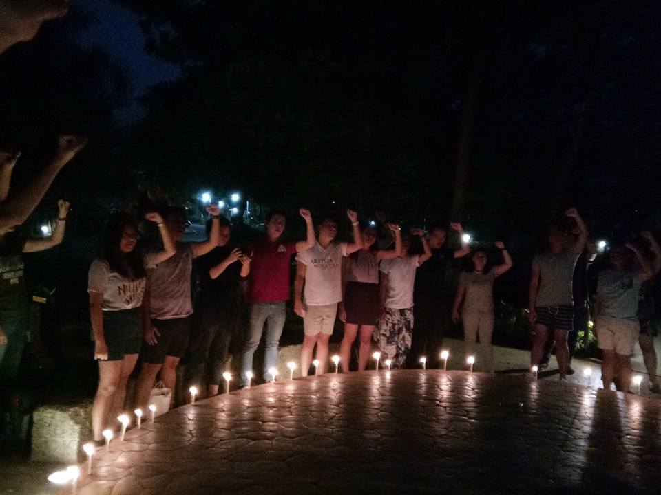 Students of the University of the Philippines-Diliman lit candles at the Dap-ayan, College of Mass Communications, to give tribute to Karen Empeno and Sherlyn Cadapan on June 26, on the 11th year of their disappearance (Photo by Daniel Boone/Bulatlat)