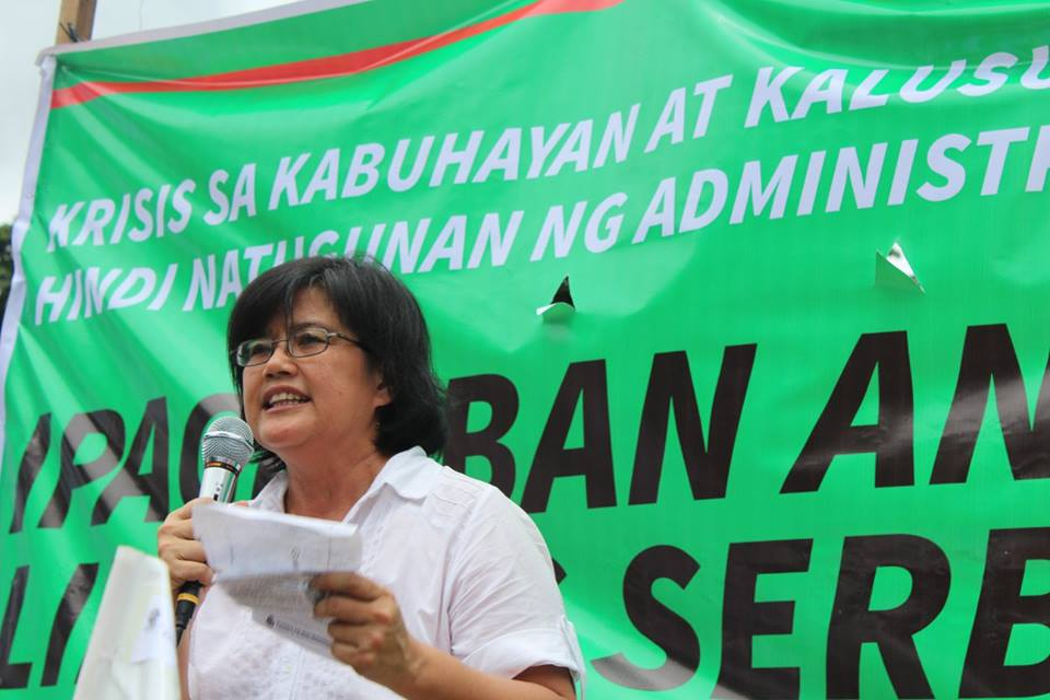 Dr. Julie Caguiat, co-convenor of Coalition for People's Right to Health speaking in a program at Chino Roces bridge on July 19. (Contributed photo)