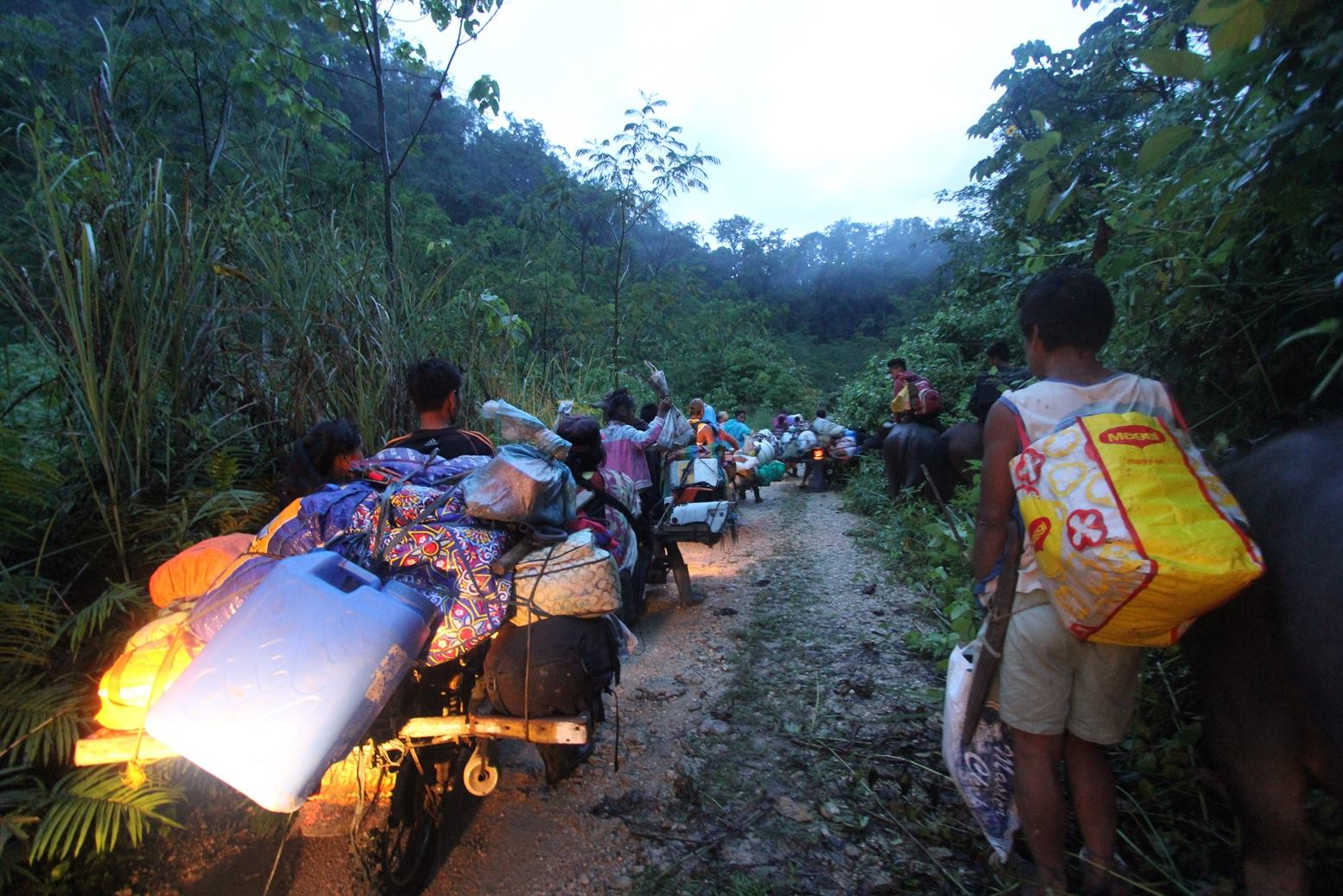 Lumad residents of Diatagon village evacuate on July 5 (Photo grabbed from Chad Booc Facebook)