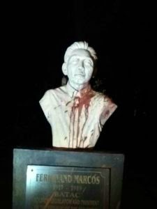 Ilocano Kabataang Makabayan vandalizes Marcos bust in Laoag City
