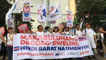 Festive but defiant, teachers call for better wage